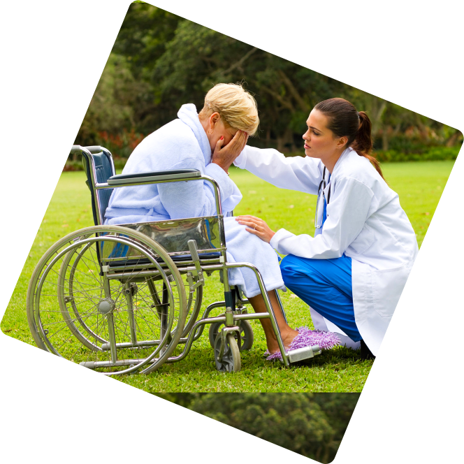 Female elder in wheelchair crying and female caregiver