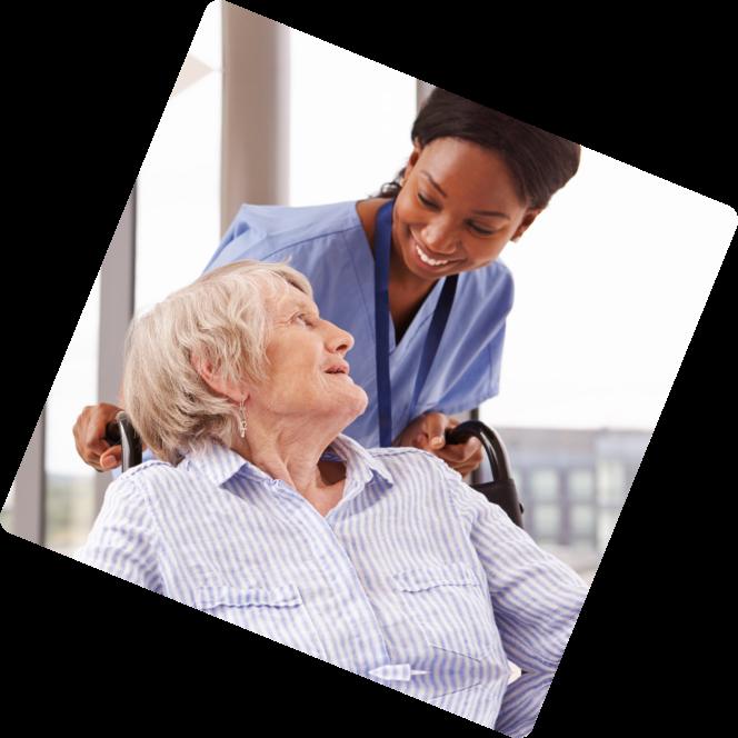 Elder in wheelchair and caregiver